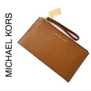 NWT authentic MK genuine leather wristlet